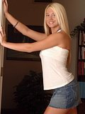 Busty Blonde Alison Angel posing in tiny jean shorts