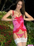 Beautiful Kate posing outdoors in hot red lingerie from Kate's Playground