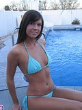 Sweet Adri posing by the pool in a tight blue bikini